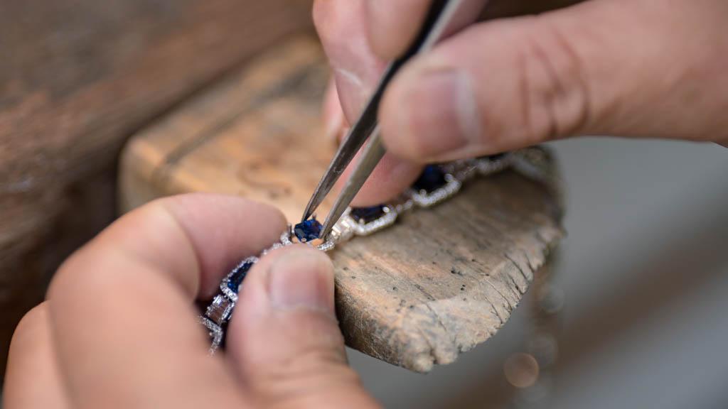 Careful metal polishing by skilled craftsman
