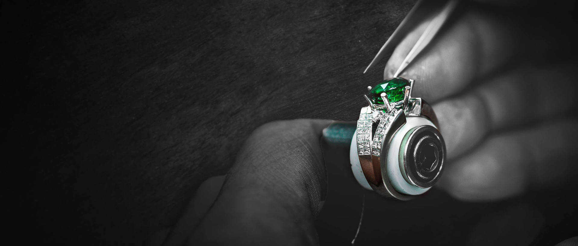 Nelson craftsman stone setting precious emerald into a18 karat gold diamond semi mounted fine jewellery ring